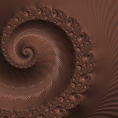 Dunklere Schokoladenmasse mit Spiralmuster